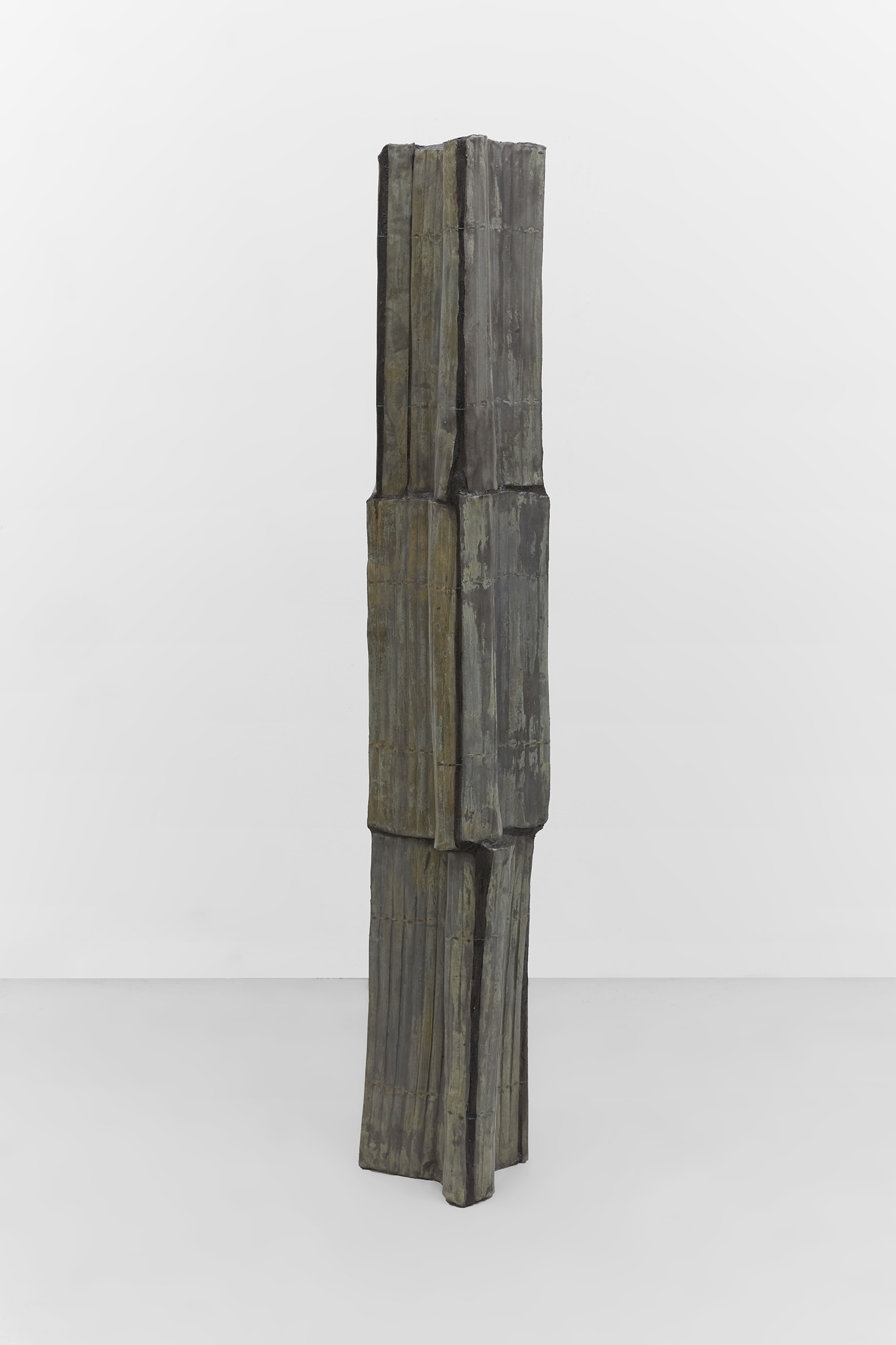 Anne Libby, Total Partial Annular, 2020, glazed ceramic, steel, sanded grout, 66h x 12w x 12d in.