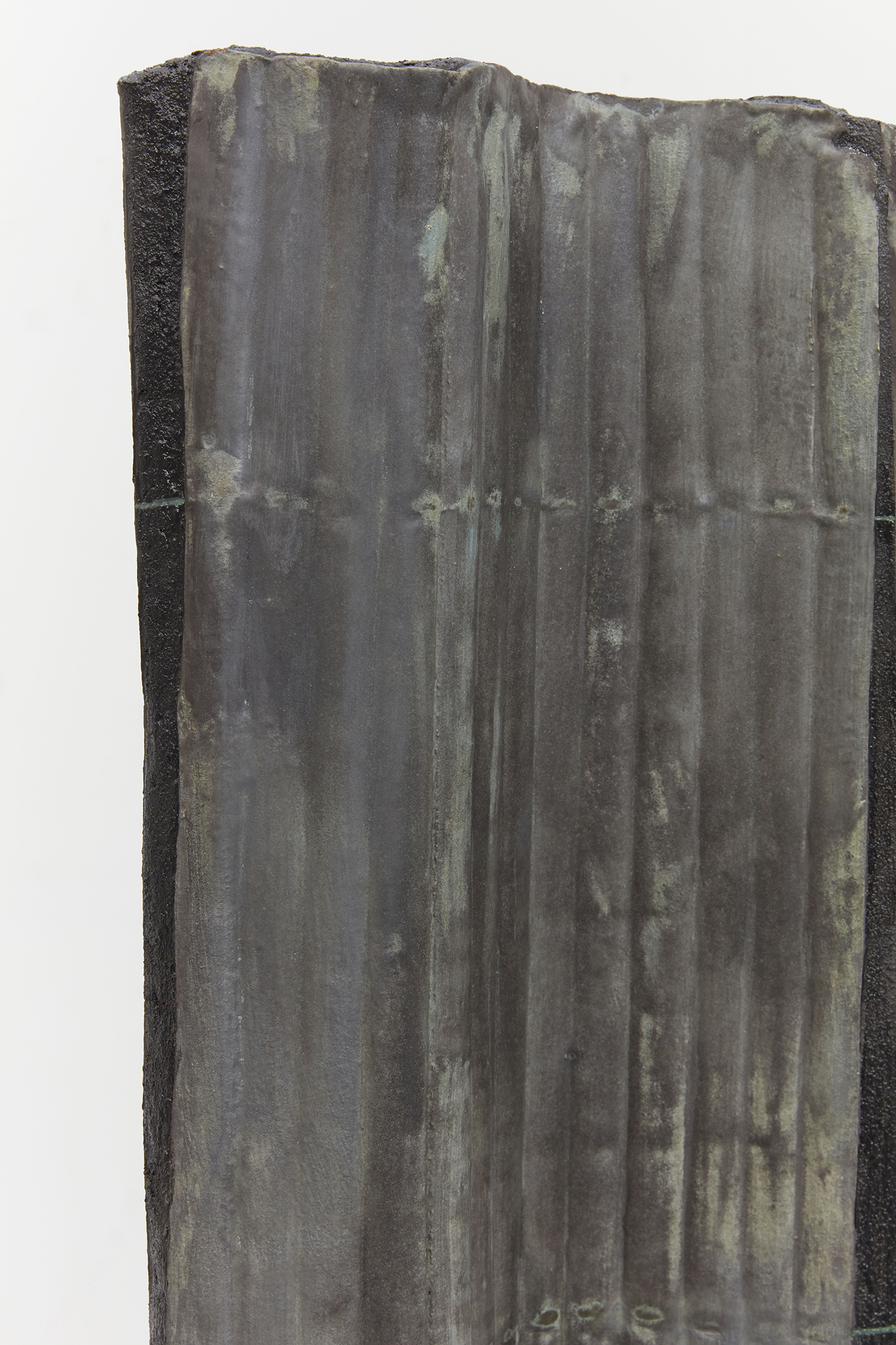 Anne Libby, Total Partial Annular (detail), 2020, glazed ceramic, steel, sanded grout, 66h x 12w x 12d in.