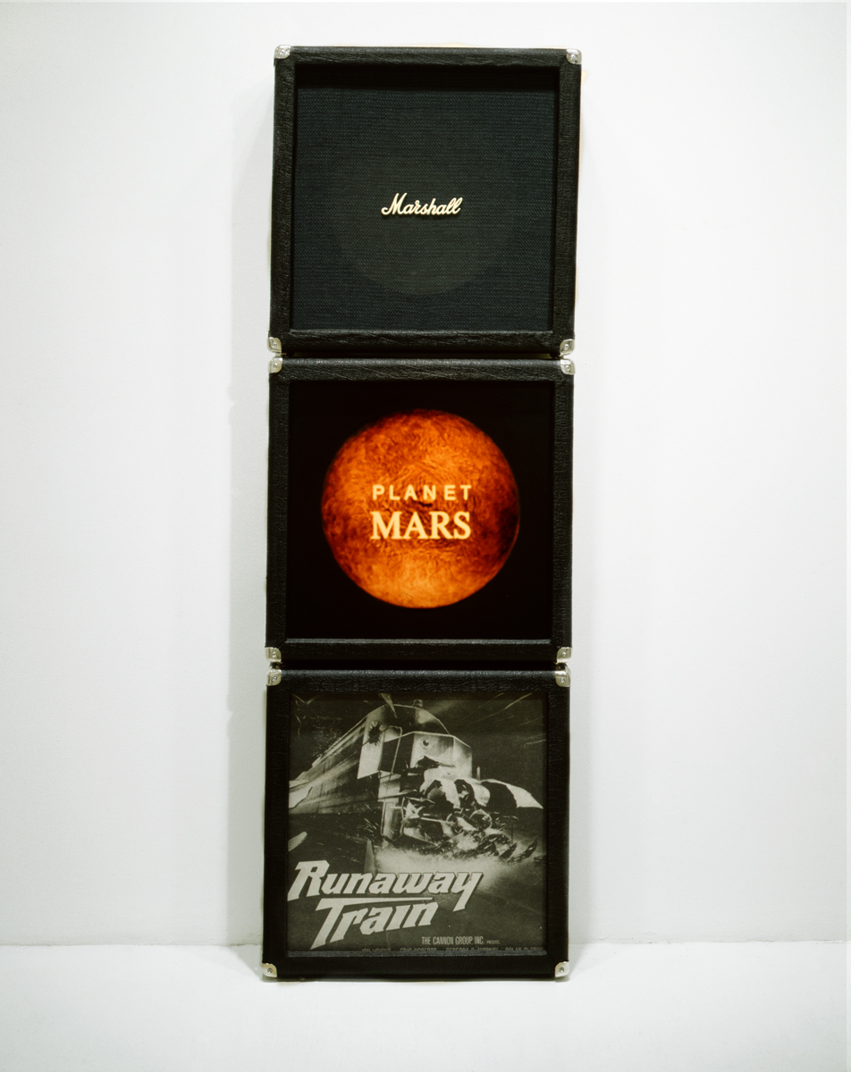 Jennifer Bolande,  Marshall Stack, 1987, 3 handmade vinyl and wood speaker cabinets, color photos, Marshall speaker cloth, plastic Marshall logo, 69h x 22.5w x 6.5d in.