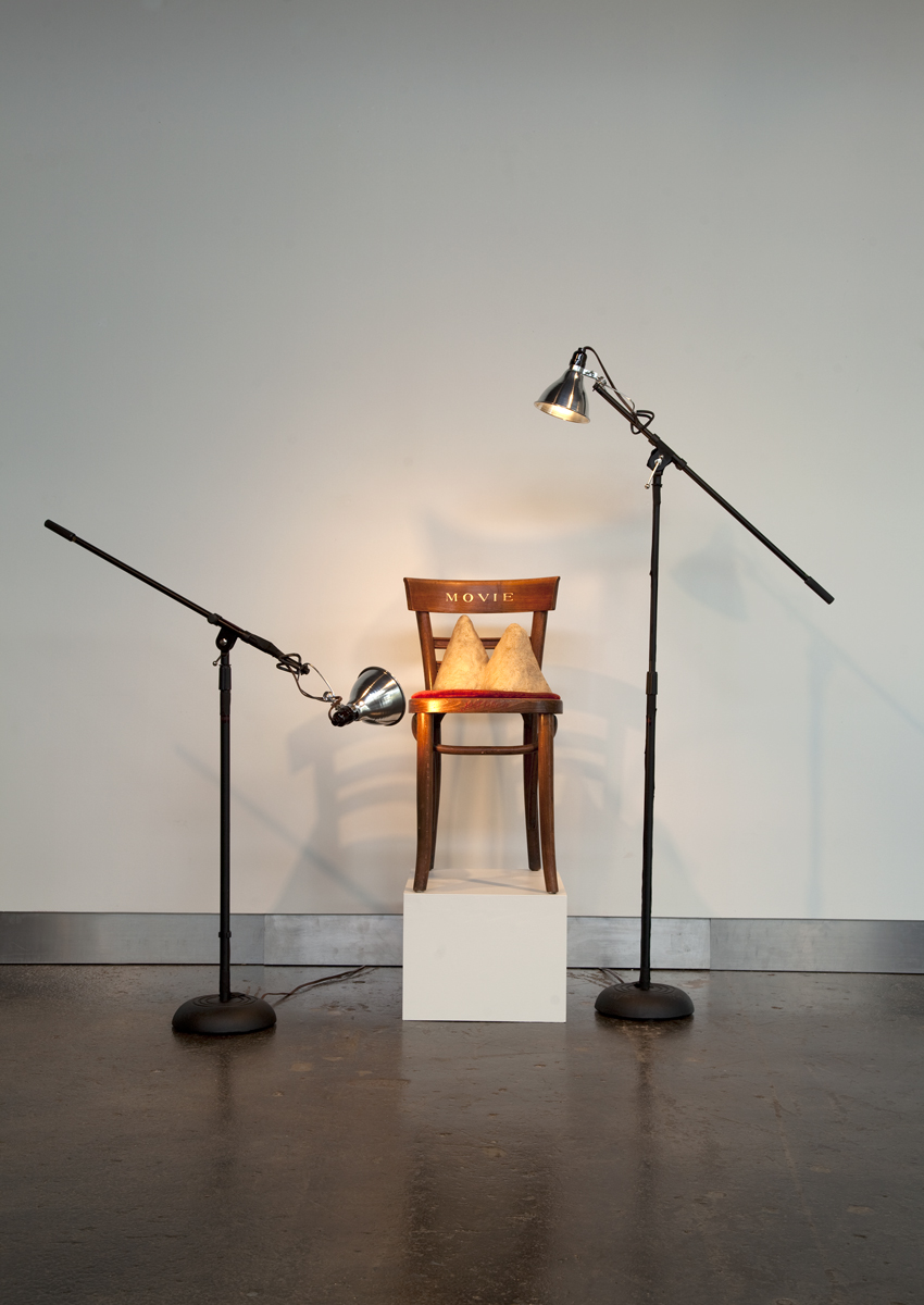 Jennifer Bolande, Movie Chair, 1984, wooden chair, velvet, bronze, enamel paint, light stands, lights, gaffer's tape, 60h x 72w x 36d in.