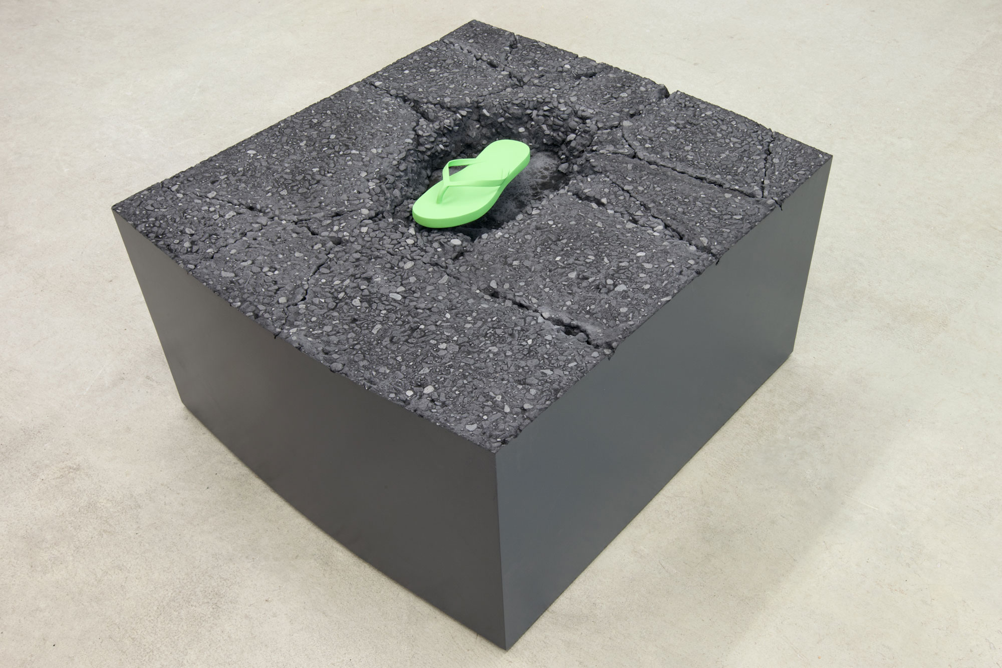 Nathaniel Robinson, Freeze/Thaw (Flip-Flop), 2015, polymer modified gypsum cement, glass fiber, wood, steel and paint, 14h x 26w x 23d in.